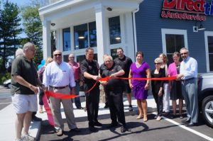 Direct Tire Ribbon Cutting
